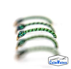 Amettiera da coregone lavarello verde intenso, con rigatura nera e testa voluminosa in glitter. Ricoperta in riflettente UV, assicura una buona visibilità anche a profondità sostenute.