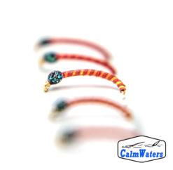 Amettiera per lavarello coregone su base rossa con rigatura gialla e voluminosa testa in glitter brillantini su base verde. Il riflettente UV aumenta la visibilità in profondità.