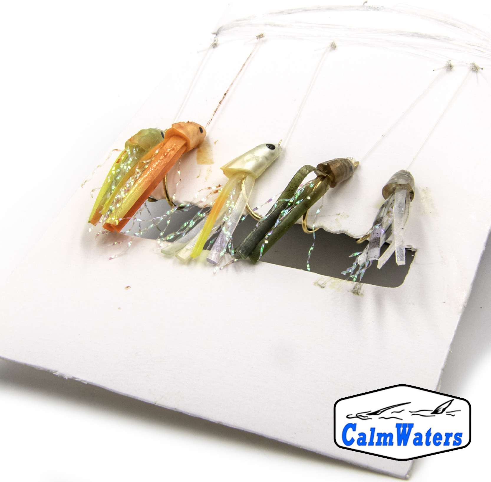 Amettiera per persico reale montata su amo dorato del 6. Corpi in silicone e materiali sintetico di colori differenti con l'aggiunta di fibre riflettenti per aumentare la visibilità. Montatura pronta all'uso.